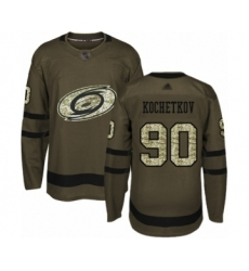 Men's Carolina Hurricanes #90 Pyotr Kochetkov Authentic Green Salute to Service Hockey Jersey